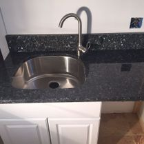 Black Quartz Around Stainless Steel Sink