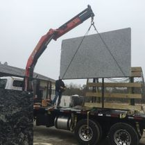 Granite Being Loaded Into Truck