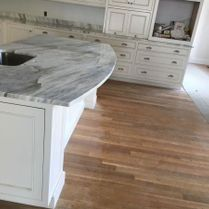 Beautiful Marble Counter and White Cabinets